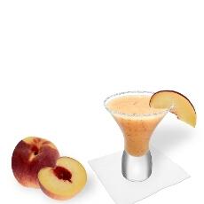 Cancun glass with peach margarita