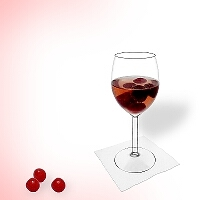 Cherry punch in a red wine glass.