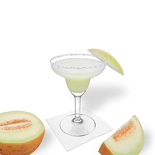 Frozen Melon Margarita served in a Margarita glass with a piece of melon and sugar or salt rim, the common way of presenting that fruity tequila cocktail.