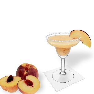 Frozen Peach Margarita served in a Margarita glass with a slice of peach and sugar or salt rim, the common way of presenting that fruity tequila cocktail.