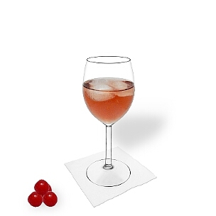 Kir served in a red wine glass, the most common way of presenting that delicious cocktail.