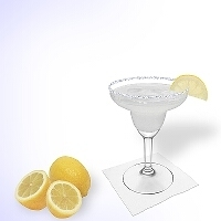 Margarita served in a margarita glass with lemon decoration and a sugar or salt rim.