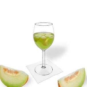 Melon Punch served in a red wine glass, the common way of presenting that delicious party mixture.