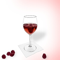 Raspberry punch in a red wine glass.