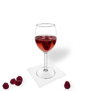 Raspberry Punch served in a red wine glass, the common way of presenting that delicious party mixture.