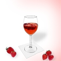 Strawberry punch in a wine glass.