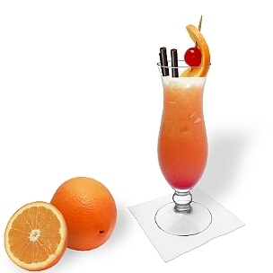 Tequila Sunrise served in a hurricane glass, a great option to present that eye-catching summer cocktail.