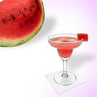 Watermelon Margarita served in a margarita glass with watermelons and sugar or salt rim.