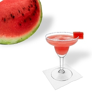 Watermelon Margarita served in a Margarita glass with a cube of watermelon and sugar or salt rim, the common way of presenting that fruity tequila cocktail.